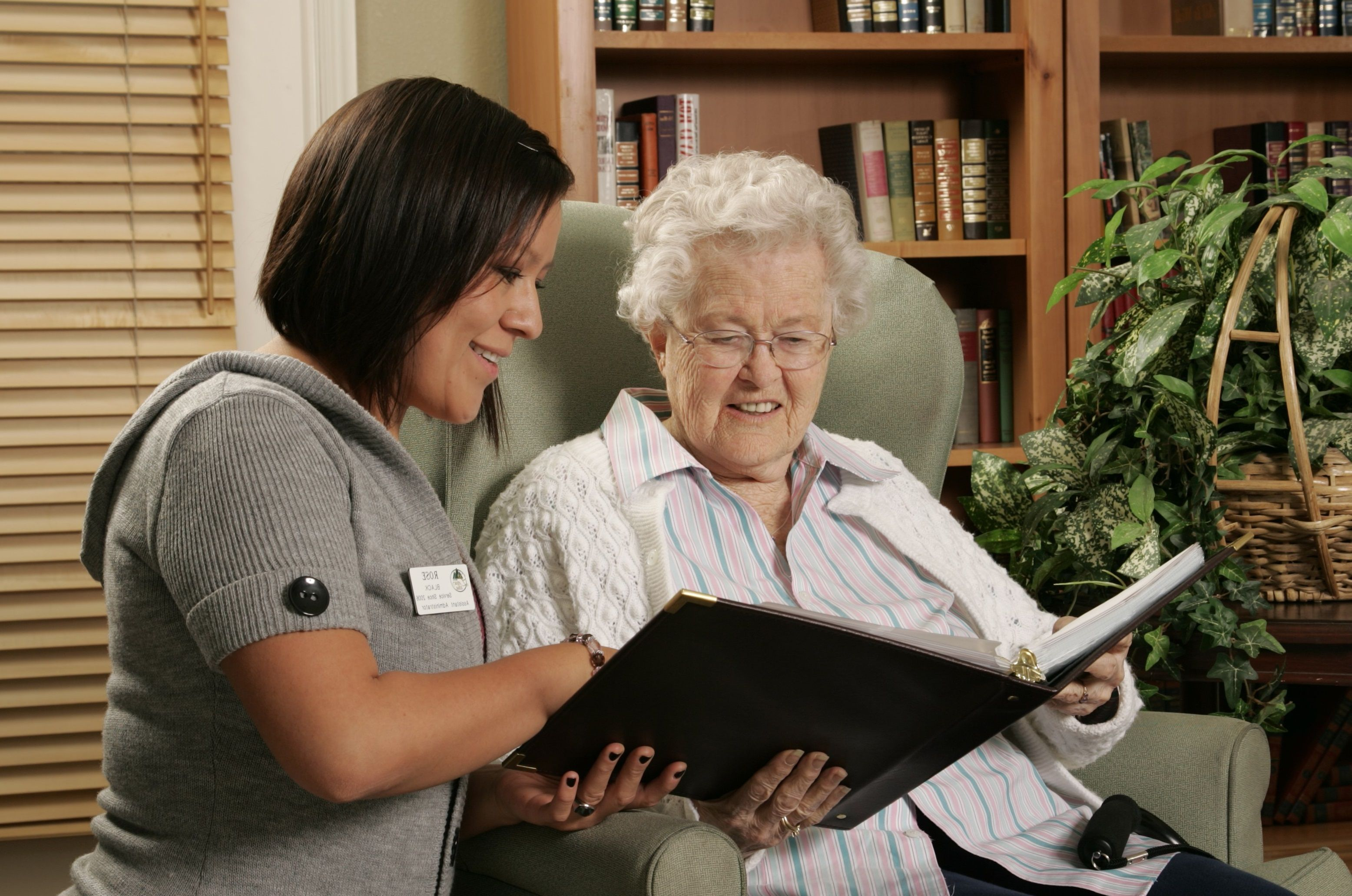 Woman Reading to a Resident